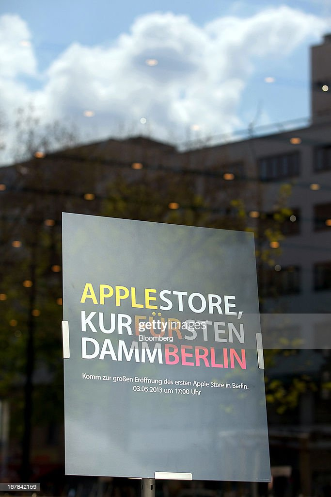 A sign sits in the doorway of the new Apple Inc. store located on Kurfurstendamm Street advising customers to the stores opening in Berlin, Germany, on Wednesday, May 1, 2013. The Berlin Apple Inc. store is the company's 11th in the country, but the first in Germany's capital city. Photographer: Krisztian Bocsi/Bloomberg via Getty Images