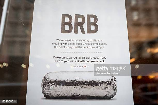 A sign sits in the window of a Chipotle restaurant on Broadway in Lower Manhattan telling customers the restaurant is closed until 3 pm on February 8...