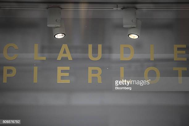 A sign sits in the window of a Claudie Pierlot luxury clothing store operated by SMCP Group in Toulouse France on Wednesday Feb 10 2016 Shandong Ruyi...