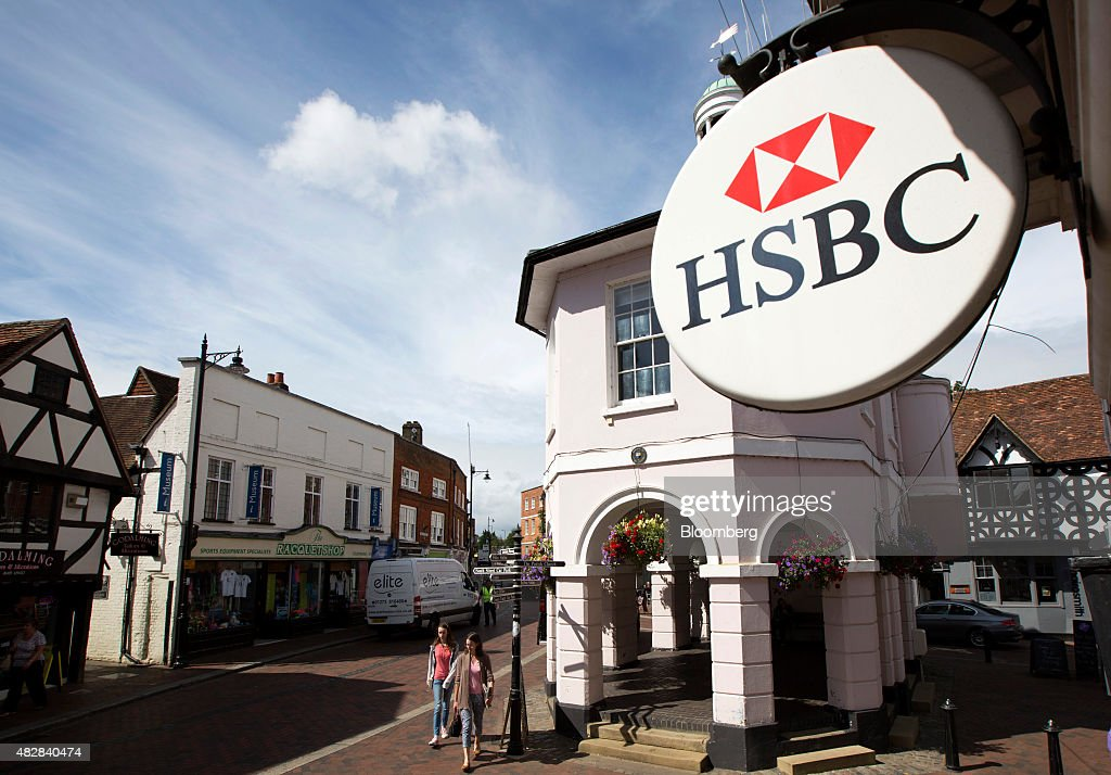 A HSBC sign sits on a HSBC bank, operated by HSBC Holdings Plc, in Godalming, U.K., on Monday, Aug. 3, 2015. HSBC, Europe's largest bank, reported an 18 percent climb in second-quarter profit amid higher trading income and gains from a sale of shares in China's Industrial Bank Co. Photographer: Jason Alden/Bloomberg via Getty Images