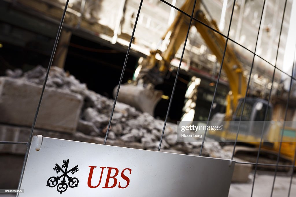 A sign sits on a security fence during construction work outside UBS AG's offices in Geneva, Switzerland, on Sunday, Feb. 3, 2013. UBS AG will report fourth-quarter results for the 2012 financial year on Feb. 5. Photographer: Valentin Flauraud/Bloomberg via Getty Images