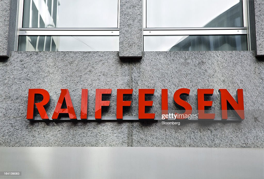 A sign sits on a wall outside the headquarters of Raiffeisen Group in St. Gallen, Switzerland, on Wednesday, March 20, 2013. Wegelin & Co., who sold Notenstein Privatbank AG to Raiffeisen Group last year, were ordered to pay U.S. authorities almost $58 million at the end of a criminal case after the Swiss bank pleaded guilty to helping American taxpayers hide more than $1.2 billion from the Internal Revenue Service. Photographer: Gianluca Colla/Bloomberg via Getty Images