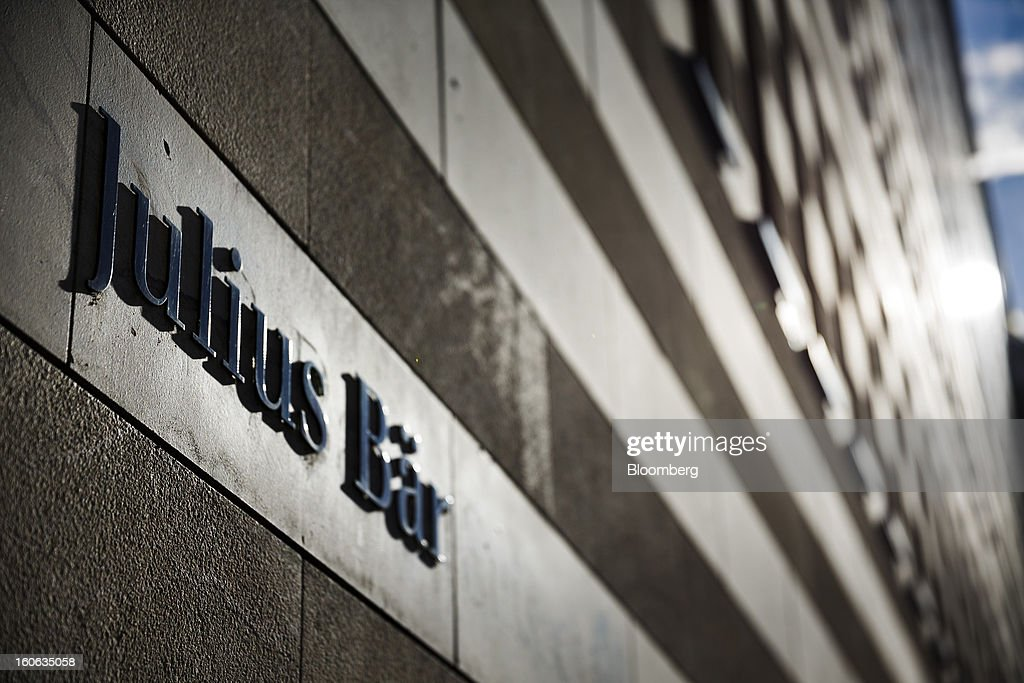 A sign sits on a wall outside the offices of Julius Baer Group Ltd. in Geneva, Switzerland, on Sunday, Feb. 3, 2013. Julius Baer Group Ltd., the third-largest Swiss wealth manager, reported declining revenue margins on assets under management as full-year profit matched analyst estimates. Photographer: Valentin Flauraud/Bloomberg via Getty Images