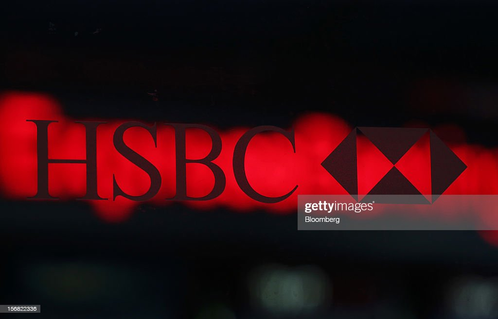 A sign sits on a window outside a HSBC Holdings Plc bank branch in London, U.K., on Thursday, Nov. 22, 2012. Shares of HSBC have climbed 26 percent this year in London trading, and 30 percent in Hong Kong, as Chief Executive Officer Stuart Gulliver pared costs and sold assets to revive profit and focus on emerging economies in which the bank has a greater market share. Photographer: Chris Ratcliffe/Bloomberg via Getty Images