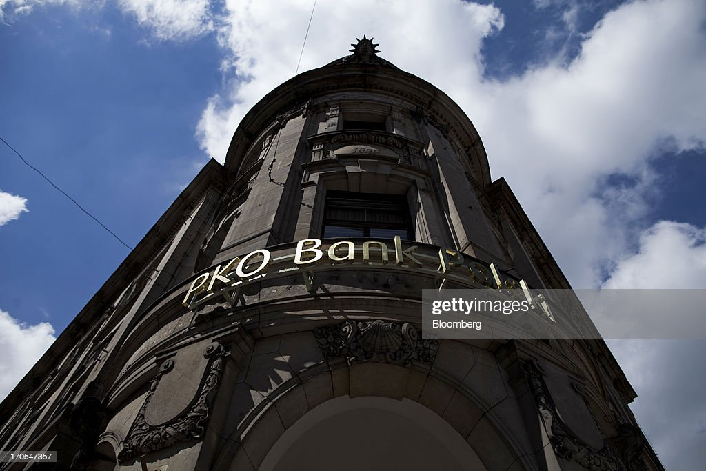 A sign sits on display above the entrance to a PKO Bank Polski SA bank branch in Wroclaw, Poland, on Friday, June 14, 2013. PKO Bank Polski SA, Poland's biggest lender, surged to a five-month high after signing an agreement to buy Nordea Bank AB's Polish assets to increase its dominance on the European Union's largest eastern market. Photographer: Bartek Sadowski/Bloomberg via Getty Images