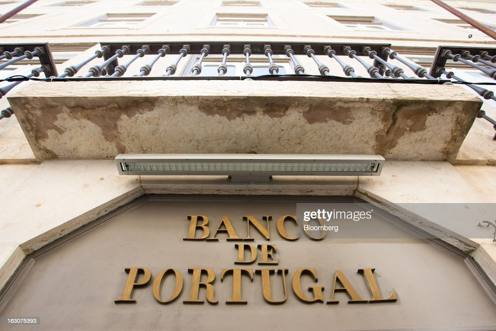 A sign sits on display above the entrance to the headquarters of Portugal's central bank in Lisbon, Portugal, on Saturday, March 2, 2013. Prime Minister Pedro Passos Coelho is battling rising joblessness and lower demand from European trading partners as he raises taxes to meet the terms of a 78 billion-euro ($104 billion) aid plan from the European Union and the International Monetary Fund. Photographer: Mario Proenca/Bloomberg via Getty Images