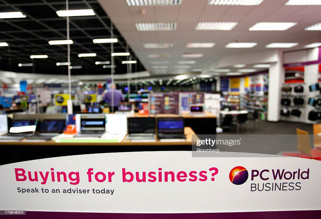 A sign sits on display inside a Currys PC World 2 in 1 store, operated by Dixons Retail Plc, in Manchester, U.K., on Tuesday, June 18, 2013. Dixons Retail Plc, the U.K.'s largest consumer-electronics retailer, said last month it will report annual pretax profit at the 'top end' of analysts' predictions after fourth-quarter revenue beat estimates on increased sales of tablets and services such as software tutorials. Photographer: Paul Thomas/Bloomberg via Getty Images