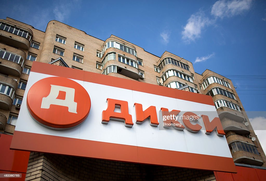 A sign sits on display outside a Dixy supermarket operated by OAO Dixy Group beneath a residential housing block in Moscow, Russia, on Tuesday, April 8, 2014. Suppliers suffering from ruble depreciation this quarter are urging retailers to increase prices. Photographer: Andrey Rudakov/Bloomberg via Getty Images