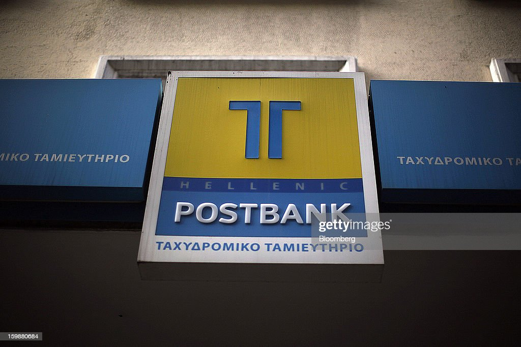 A sign sits on display outside an Hellenic Postbank SA bank branch in Athens, Greece, on Tuesday, Jan. 22, 2013. Euro-area finance ministers blessed the next disbursement of emergency aid for Greece, highlighting the goodwill that led to the unblocking of loans last month for Prime Minister Antonis Samaras's government. Photographer: Kostas Tsironis/Bloomberg via Getty Images
