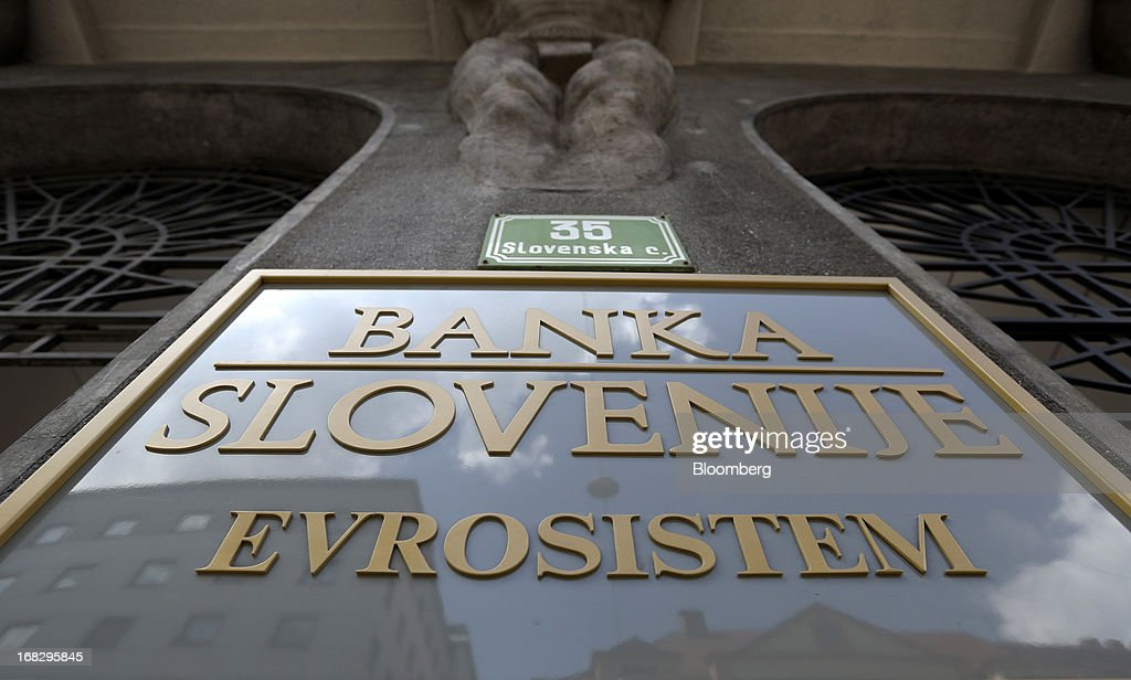 A sign sits on display outside the headquarters of the Slovenian central bank in Ljubljana, Slovenia, on Tuesday, May 7, 2013. Slovenia plans to increase taxes to make up for the swelling budget shortfall as the country works to recapitalize its banks. Photographer: Chris Ratcliffe/Bloomberg via Getty Images