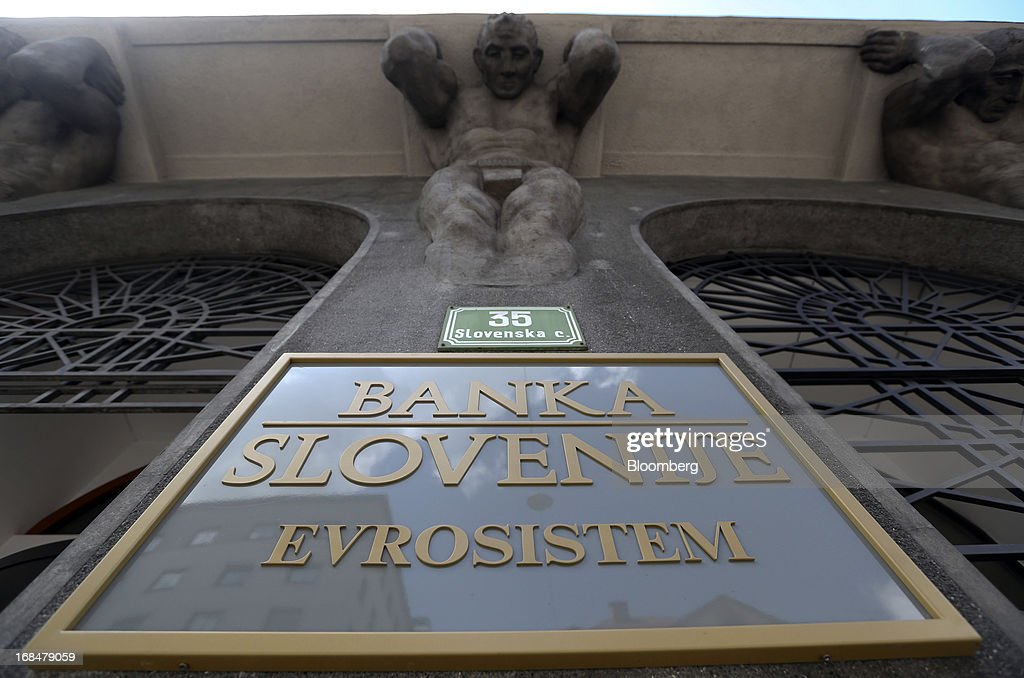 A sign sits on display outside the headquarters of the Slovenian central bank, also known as Banka Slovenije, in Ljubljana, Slovenia, on Tuesday, May 7, 2013. Slovenia plans to increase taxes to make up for the swelling budget shortfall as the country works to recapitalize its banks. Photographer: Chris Ratcliffe/Bloomberg via Getty Images
