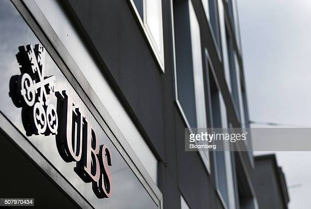 A sign sits on the exterior of the UBS AG headquarters ahead of a full year results news conference in Zurich Switzerland on Tuesday Feb 2 2016 UBS...