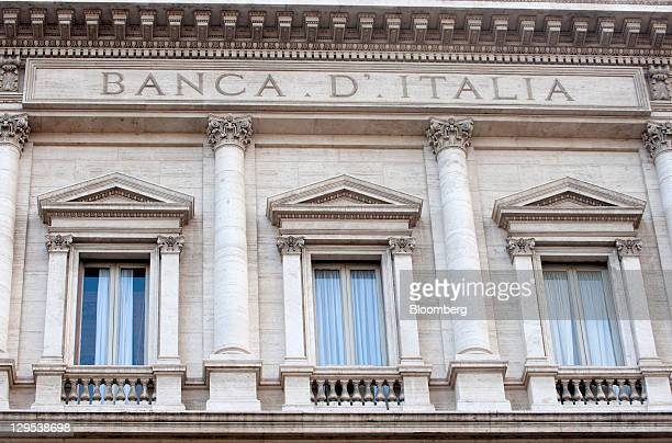A sign sits on the wall of the Banca d'Italia Italy's central bank in Rome Italy on Tuesday Oct 18 2011 Italy has a 'deep need to reactivate growth'...