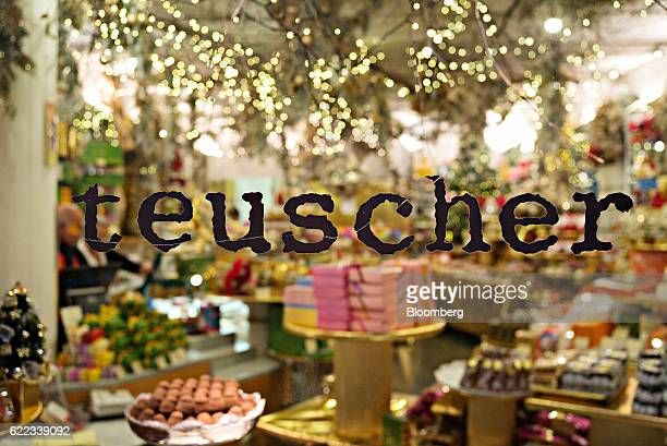 A sign sits on the window of a Confiserie Teuscher AG chocolatier in Zurich Switzerland on Wednesday Nov 9 2016 Donald Trump's ascendancy to the...