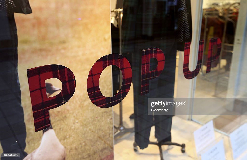 A sign sits on the window of a Jigsaw pop-up clothes store in London, U.K., on Tuesday, Nov. 27, 2012. Fashion chain Hobbs is among those that have opened pop-up stores for the first time this year, while CD and DVD retailer HMV Group Plc is adding more than usual for the holiday in an effort to win business. Photographer: Chris Ratcliffe/Bloomberg via Getty Images