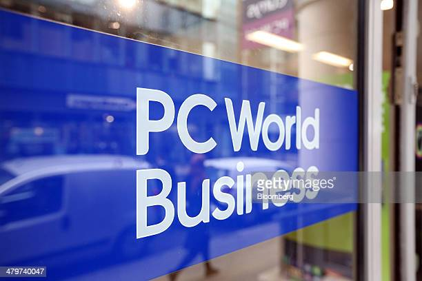 A sign sits on the window of an automatic door outside a PC World store operated by Dixons Retail Plc in London UK on Thursday March 20 2014 Dixons...