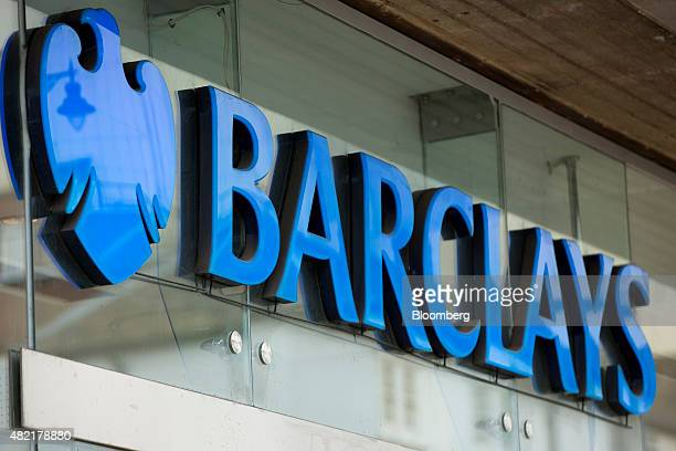 A sign sits outside a Barclays bank operated by Barclays Plc in Guildford UK on Monday July 2015 Barclays Plc should pick an investment banker as its...