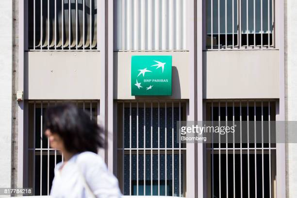 A sign sits outside a BNP Paribas SA bank branch in Paris France on Tuesday July 18 2017 BNP Paribas agreed to pay $246 million to settle Federal...