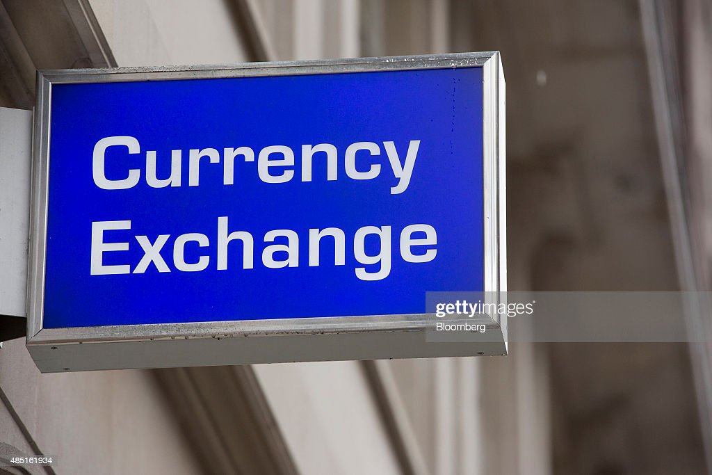 A sign sits outside a Travelex UK Ltd. currency exchange in London, U.K., on Monday, Aug. 24, 2015. European stocks rallied with U.S. equity-index futures after Monday's $2.7 trillion global equity wipeout, while the yen retreated with gold. Photographer: Jason Alden/Bloomberg via Getty Images