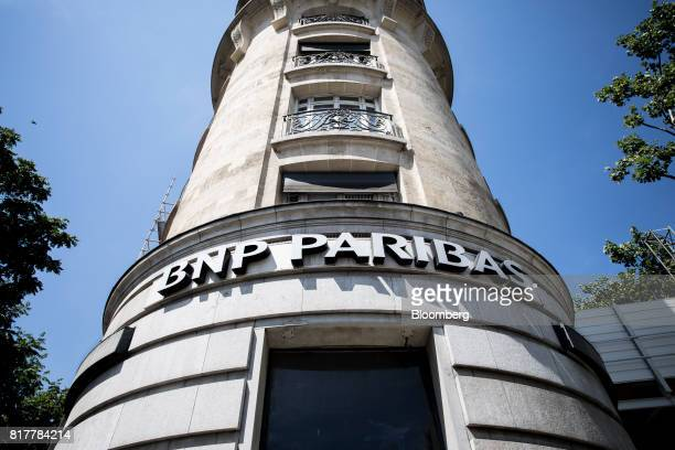 A sign sits outside the BNP Paribas SA headquarters in Paris France on Tuesday July 18 2017 BNP Paribas agreed to pay $246 million to settle Federal...