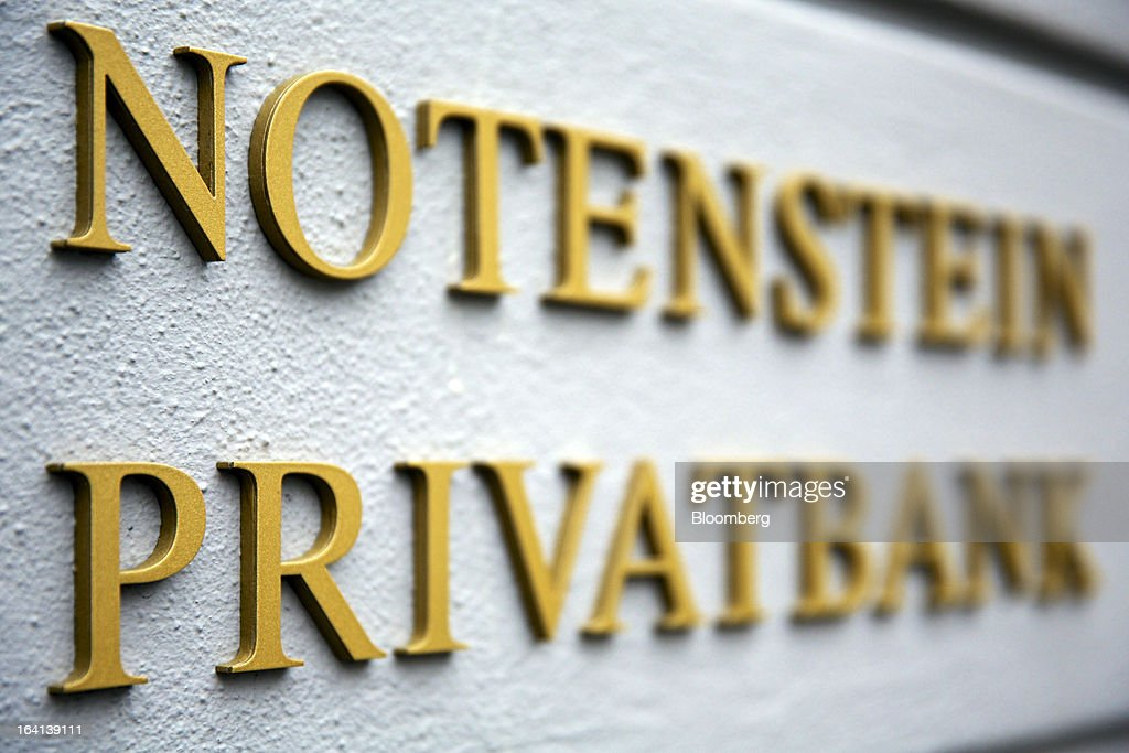 A sign sits outside the headquarters of Notenstein Privatbank AG, formerly the headquarters of Wegelin & Co., in St. Gallen, Switzerland, on Wednesday, March 20, 2013. Wegelin & Co., who sold Notenstein Privatbank AG to Raiffeisen Group last year, were ordered to pay U.S. authorities almost $58 million at the end of a criminal case after the Swiss bank pleaded guilty to helping American taxpayers hide more than $1.2 billion from the Internal Revenue Service. Photographer: Gianluca Colla/Bloomberg via Getty Images