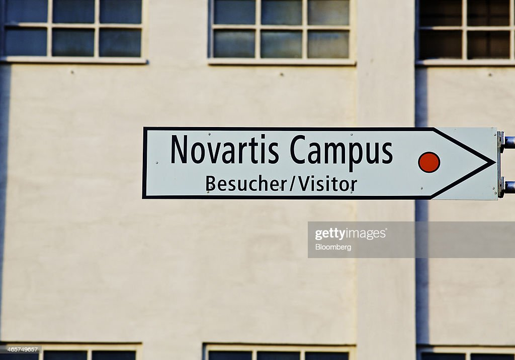 A sign sits outside the headquarters of Novartis AG in Basel, Switzerland, on Wednesday, Jan. 29, 2014. Novartis AG, Europe's biggest drugmaker by sales, said fourth-quarter profit fell as currencies in emerging markets weakened against the dollar. Photographer: Gianluca Colla/Bloomberg via Getty Images