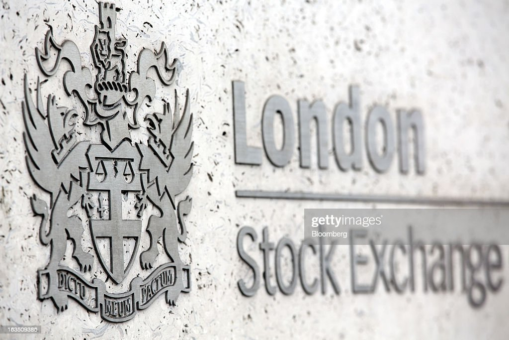 A sign sits outside the main entrance of the London Stock Exchange Group Plc's (LSE) headquarters in London, U.K., on Monday, March 11, 2013. European stocks fell from a 4 1/2-year high as Fitch Ratings downgraded Italy and China's retail sales and industrial output missed forecasts. Photographer: Jason Alden/Bloomberg via Getty Images