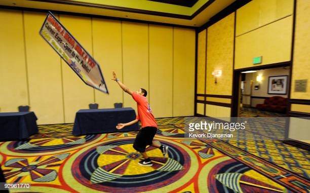 Sign spinner Steven Garcia with Aarrow advertising practices in a ballroom at a job fair titled 'Honor a Hero Hire a Vet' that attracted hundreds of...