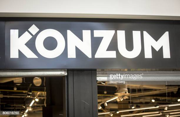 A sign stands above the entrance to a Super Konzum supermarket operated by Agrokor dd in Zagreb Croatia on Tuesday June 13 2017 Croatian retailer...