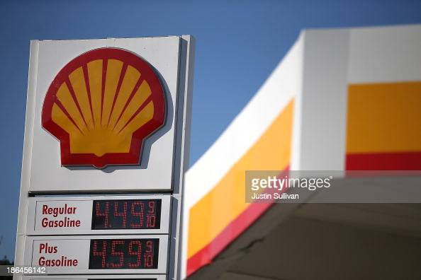 A sign stands at a Shell gas station on October 31 2013 in San Francisco California Royal Dutch Shell reported a 32% decline in third quarter profits...
