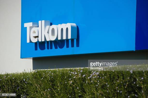 A sign stands at the entrance to the Telkom SA SOC Ltd head office in the Centurion district of Johannesburg South Africa on Tuesday July 25 2017...