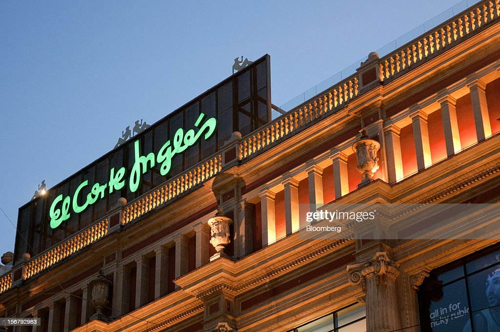 A sign stands illuminated above the El Corte Ingles department store at Portal del Angel in Barcelona, Spain, on Tuesday, Nov. 20, 2012. Bank of Spain Governor Luis Maria Linde said the government risks missing its budget targets this year and next, adding to doubts on Prime Minister Mariano Rajoy's ability to cut the deficit amid a five-year slump. Photographer: Stefano Buonamici/Bloomberg via Getty Images
