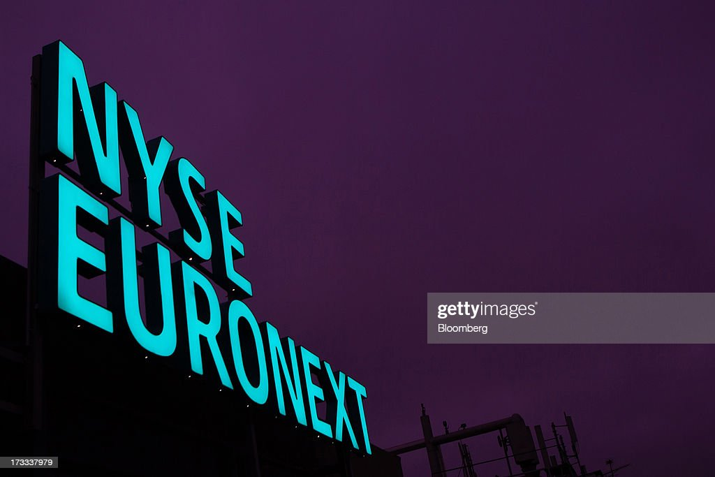 A sign stands illuminated above the offices of the NYSE Euronext Lisbon stock exchange in Lisbon, Portugal, on Thursday, July 11, 2013. NYSE Euronext, whose Liffe exchange is the biggest market for short-term interest rate derivatives, is vowing to restore confidence in the London benchmark Libor at the heart of the financial world's biggest scandal. Photographer: Mario Proenca/Bloomberg via Getty Images