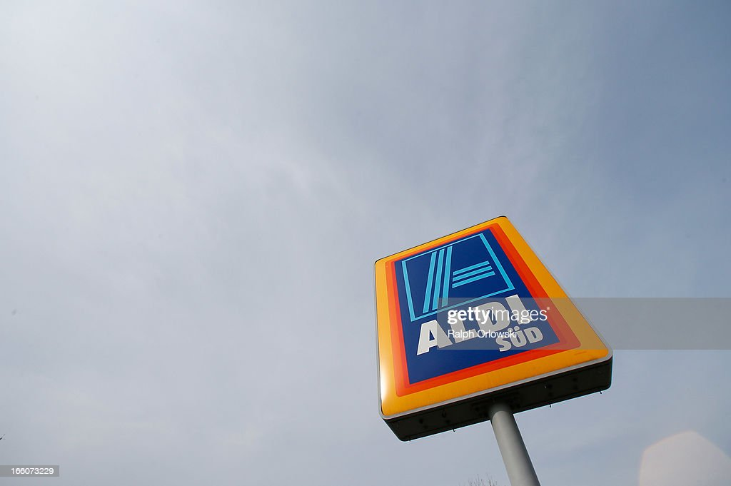 A sign stands near an Aldi store on April 8, 2013 in Ruesselsheim near Frankfurt, Germany. Aldi, which today is among the world's most successful discount grocery store chains, will soon mark its 100th anniversary and traces its history back to Karl Albrecht, who began selling baked goods in Essen on April 10, 1913 and founded the Aldi name by shortening the phrase Albrecht Discount. His sons Karl Jr. and Theo expanded the chain dramatically, creating 300 stores by 1960 divided between northern and southern Germany, with Aldi Nord and Aldi Sued, respectively. Today the two chains have approximately 4,300 stores nationwide and have also expanded into other countries across Europe and the USA. Aldi Nord operates in the USA under the name Trader Joe's.
