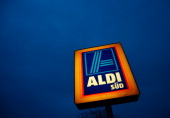 A sign stands near an Aldi store on April 8 2013 in Ruesselsheim near Frankfurt Germany Aldi which today is among the world's most successful...
