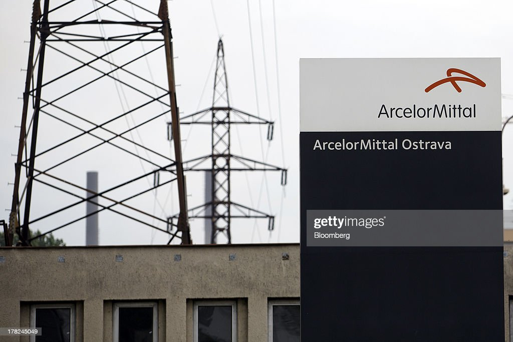 A sign stands near electricity pylons supporting power transmission lines leading away from ArcelorMittal's steel plant in Ostrava, Czech Republic, on Monday, Aug. 26, 2013. ArcelorMittal, the world's biggest steelmaker, said steel shipments will rise 1 percent to 2 percent this year compared with an earlier forecast of 2 percent in May. Photographer: Martin Divisek/Bloomberg via Getty Images