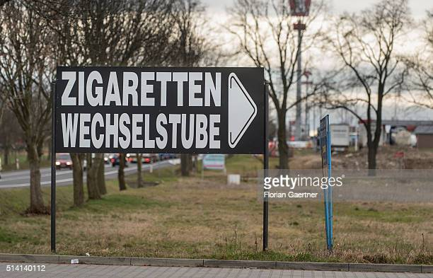 A sign stands next to an cantor and shop for cigarettes near the germanpolish border on February 08 2016 in Zgorzelec Poland