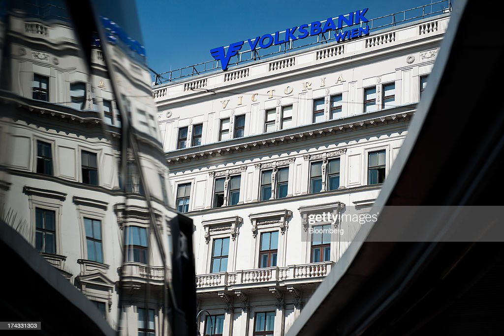 A sign stands on display above the offices of Volksbank International AG, also known as Oesterreichische Volksbanken AG, in Vienna, Austria, on Tuesday, July 23, 2013. Kommunalkredit Austria AG, the Austrian nationalized municipal lender, will have to wind down its loan book and close when that's complete after attempts to sell the bank failed, the European Commission said. Photographer: Akos Stiller/Bloomberg via Getty Images