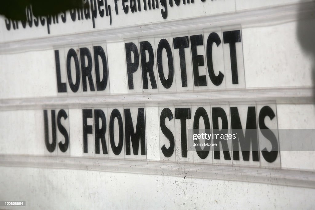 A sign stands outside a Catholic church ahead of the arrival of Hurricane Isaac to the Gulf Coast on August 28 2012 in Waveland Mississippi Many...