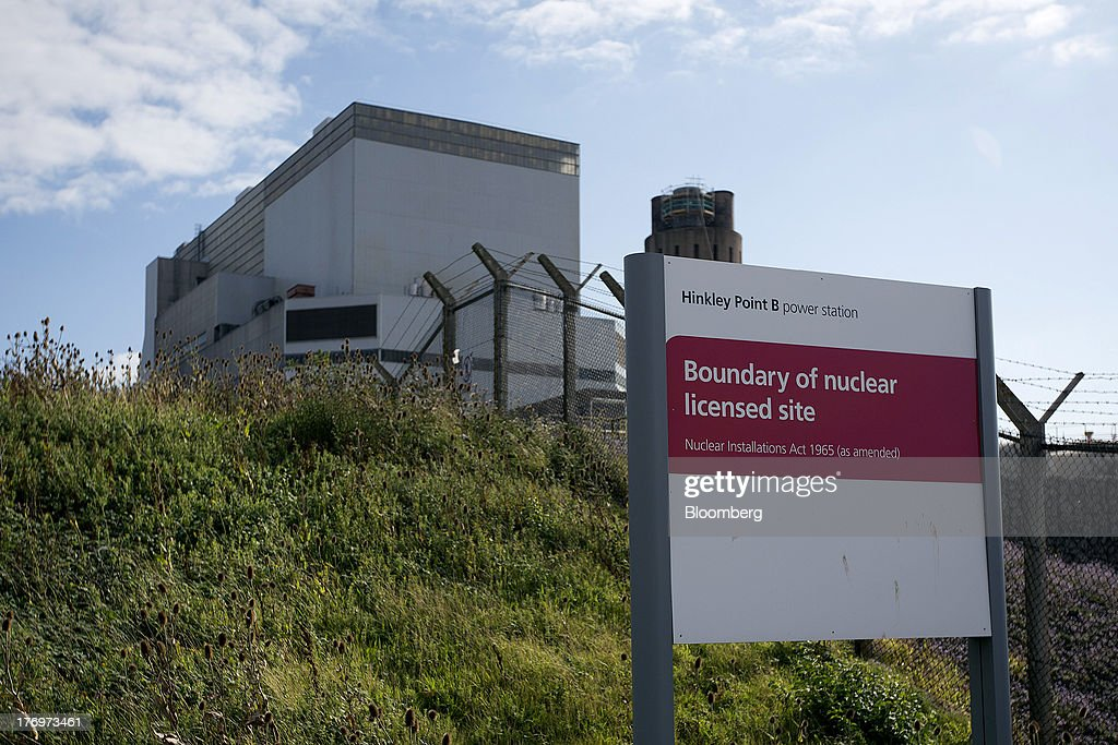 A sign stands outside Electricite de France SA's (EDF) Hinkley Point B nuclear power station near Bridgwater, U.K., on Monday, Aug. 19, 2013. EDF's plans to build two Areva SA reactors at Hinkley Point in southwest England hinge on the price it will get from the U.K. government for the power it would produce. Photographer: Simon Dawson/Bloomberg via Getty Images