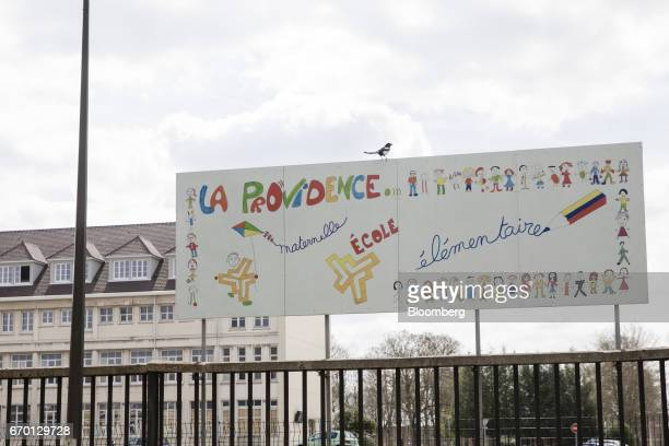 A sign stands outside La Providence school where France's Presidential Candidate Emmanuel Macron was a student in Amiens France on Tuesday April 11...