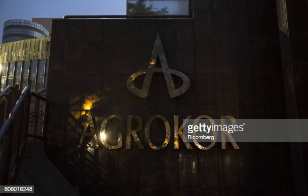 A sign stands outside the Agrokor dd headquarters office in Zagreb Croatia on Monday June 12 2017 Croatian retailer Agrokor secured a new loan of 530...