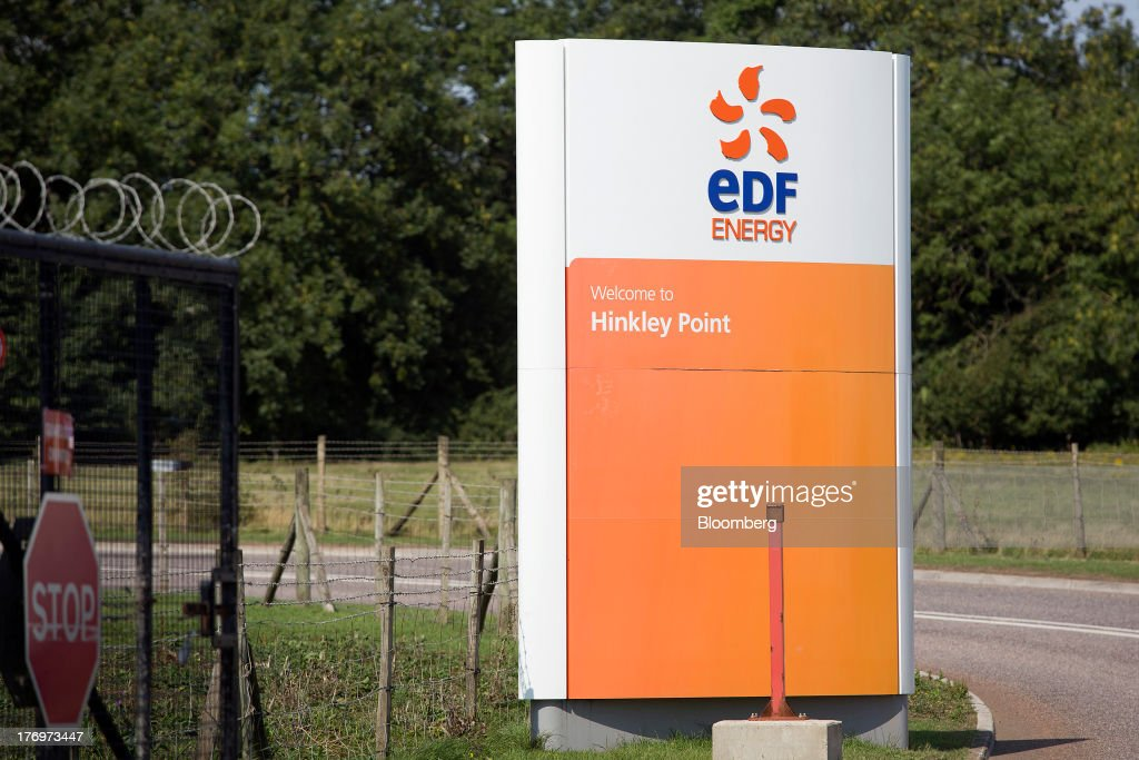 A sign stands outside the entrance to Electricite de France SA's (EDF) Hinkley Point A and B nuclear power stations near Bridgwater, U.K., on Monday, Aug. 19, 2013. EDF's plans to build two Areva SA reactors at Hinkley Point in southwest England hinge on the price it will get from the U.K. government for the power it would produce. Photographer: Simon Dawson/Bloomberg via Getty Images