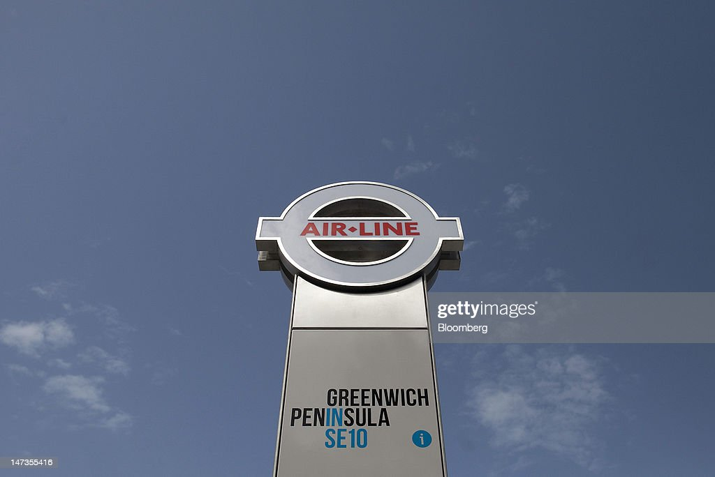 A sign stands outside the Greenwich Peninsula entrance of the Emirates Air Line cable car transport link in London, U.K., on Thursday, June 28, 2012. The cable car system, operated by Emirates, will run between Greenwich Peninsula and the Royal Victoria Docks. Photographer: Simon Dawson/Bloomberg via Getty Images