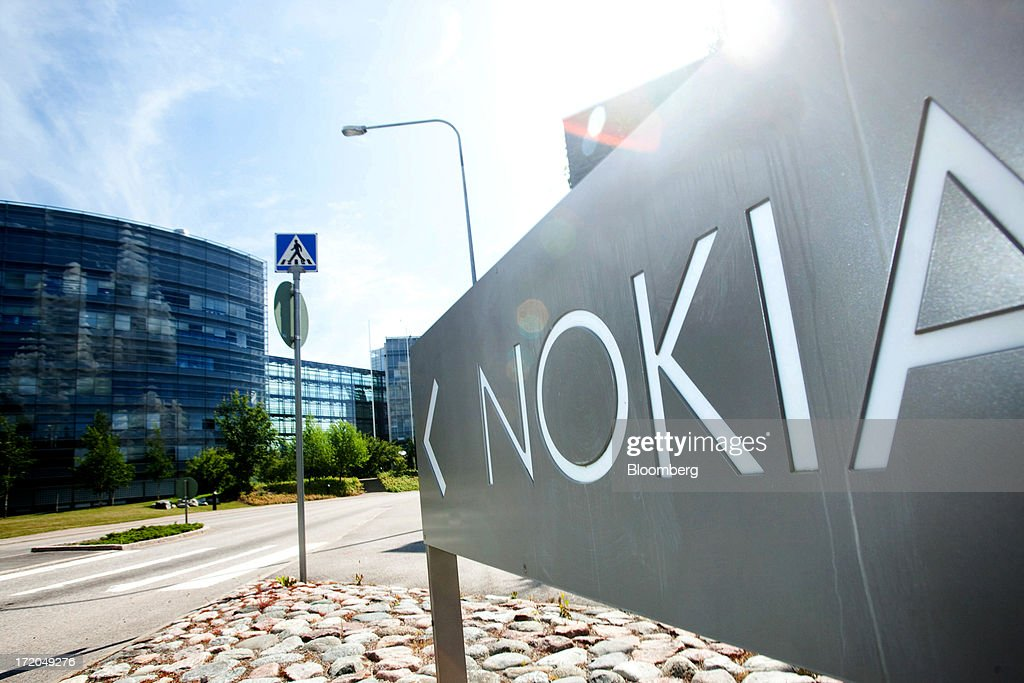 A sign stands outside the headquarters of Nokia Oyj in Espoo, Finland, on Monday, July 1, 2013. Nokia Oyj agreed to buy Siemens AG's share in a six-year venture for 1.7 billion euros ($2.2 billion), giving the Finnish company full access to the phone-equipment maker's cashflow for a less-than-estimated price. Photographer: Henrik Kettunen/Bloomberg via Getty Images