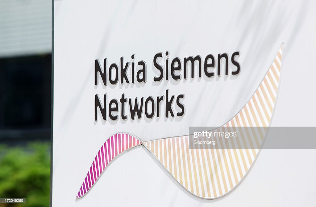 A sign stands outside the headquarters of Nokia Siemens Networks (NSN) in Espoo, Finland, on Monday, July 1, 2013. Nokia Oyj agreed to buy Siemens AG's share in a six-year venture for 1.7 billion euros ($2.2 billion), giving the Finnish company full access to the phone-equipment maker's cashflow for a less-than-estimated price. Photographer: Henrik Kettunen/Bloomberg via Getty Images