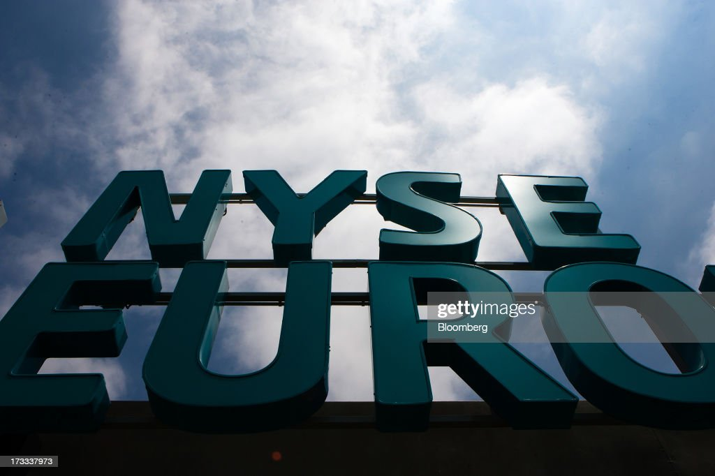 A sign stands silhouetted against the sky above the offices of the NYSE Euronext Lisbon stock exchange in Lisbon, Portugal, on Thursday, July 11, 2013. NYSE Euronext, whose Liffe exchange is the biggest market for short-term interest rate derivatives, is vowing to restore confidence in the London benchmark Libor at the heart of the financial world's biggest scandal. Photographer: Mario Proenca/Bloomberg via Getty Images