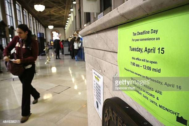 A sign states business hours in the James A Farley post office in Manhattan which is staying open until midnight today on that last day to file taxes...