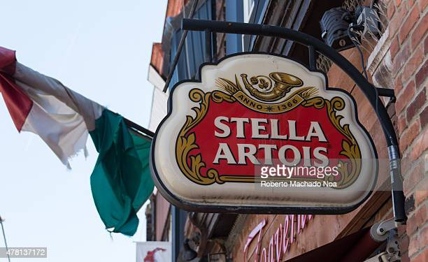 Sign Stella Artois on the building wall with the Italian flag in the background Stella Artois informally called Stella is a pilsner beer of between...