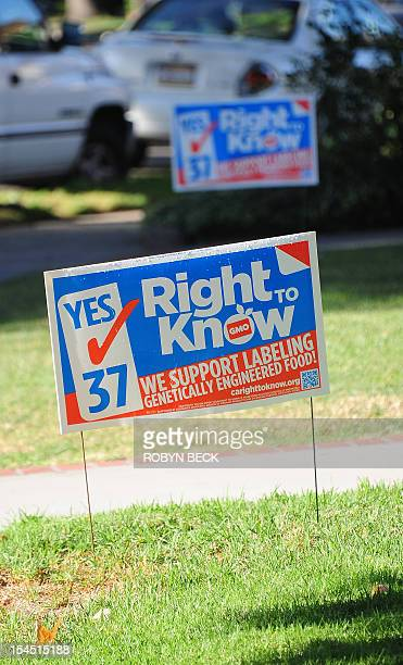 A sign supporting Proposition 37 which calls for the mandatory labeling of genetically engineered foods is seen in front of a home in Glendale...